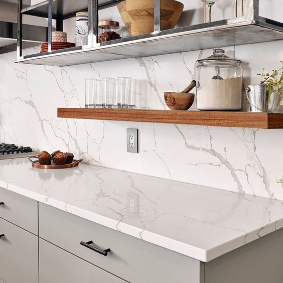 White Quartz Kitchen Backsplash - 6 Great Marble Alternatives For Around Your Home: A beautiful white kitchen quartz with grey veining provides the feature backdrop for the backsplash and the countertops in this kitchen design. @chloedominik #quartzcountertops #quartzkitchencountertops #marblealternative #marblealternativewall #marblealternativecountertops #interiortrends