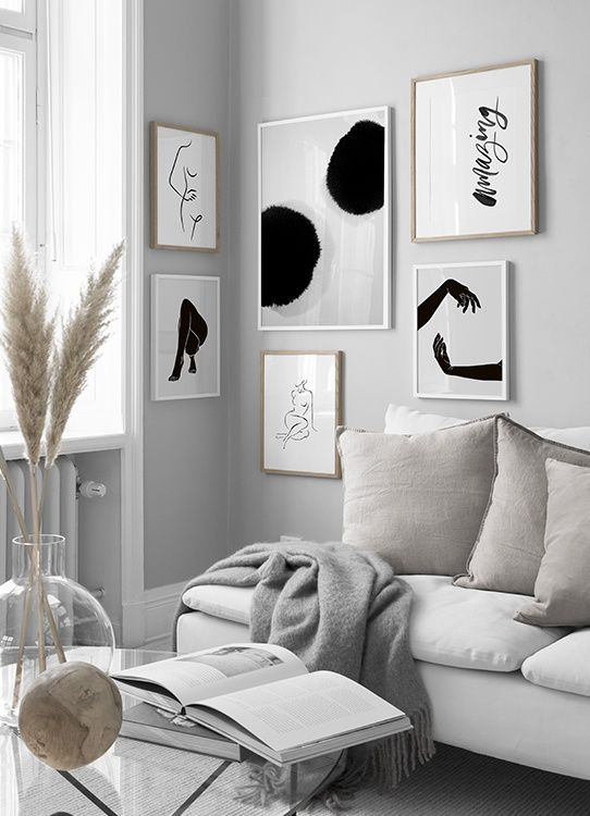 Beautiful Neutral Minimal Living Room - 7 Ways To Decorate An Empty Corner At Home: A beautiful neutral colour palette living room corner styled with complimenting minimal black and white prints to add some interest to what would have otherwise been an empty corner turning it in to a mini gallery wall corner. @chloedominik #gallerywallcorner #gallerywallcornerlivingroom #minimallivingroom #blackandwhitegallerywall #emptycornerinlivingroom #emptycornerideas