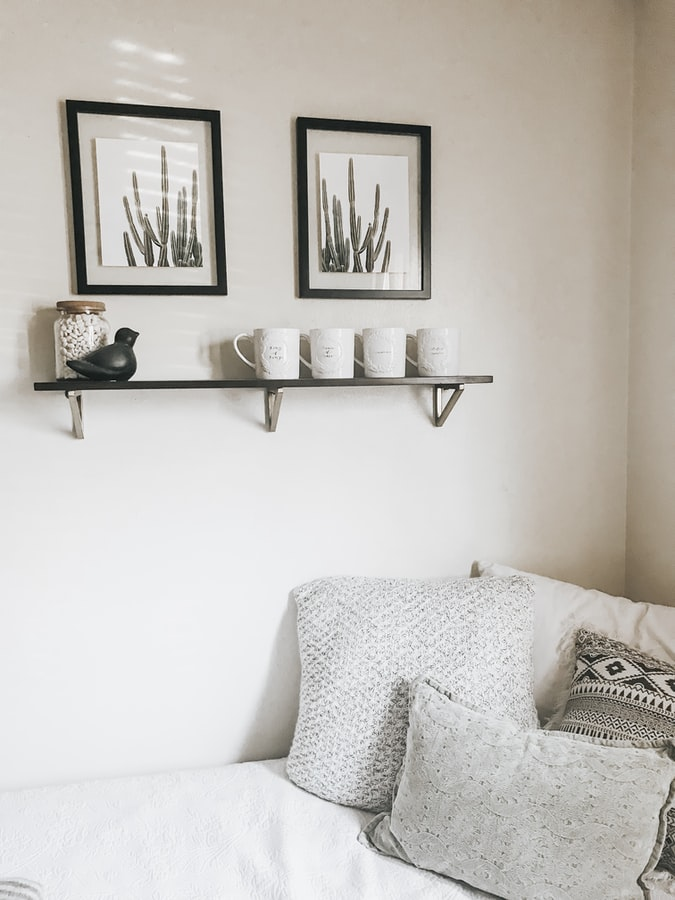 Styled Decor Bedroom Shelf - 10 Interior Design Mistakes And How To Fix Them: Clutter plays a large part in getting your interior design right. Streamline and get rid of some stuff and only put out your favourites out on display like this styled decor bedroom shelf above the bed. @chloedominik #bedroomdecor #bedroomshelfdecor #interiormistakes #interiordesigntips #shelfdecor #shelfabovebed