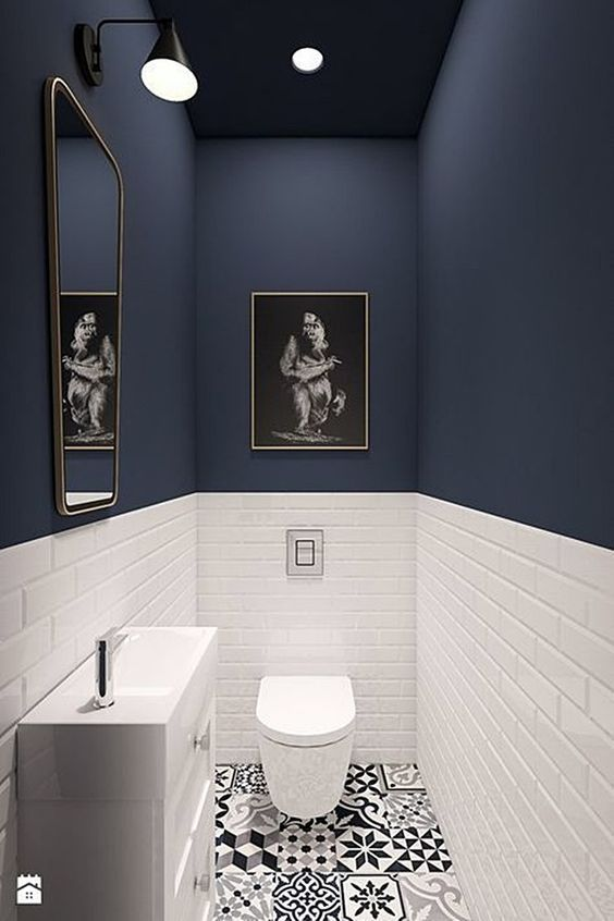 Dark Blue Powder Room - 20 Amazing Statement Ceiling Design Ideas For Your Home: A modern powder room using contrasting colours. A dark deep blue for the top and a bright white for the bottom half. @chloedominik #powderroom #powderoomideas #bathroomdecor #bluepowderroom #darkbluepowderroom