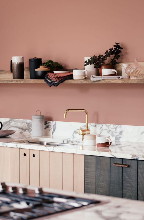 Blush and Marble Kitchen - August Pinterest 2020: Top 15 Inspiration & Ideas: A gorgeous rustic blush kitchen finished with a white marble countertop and wooden cabinet cupboard doors. The gold hardware tap adds a touch of glamour to the the kitchen design. The wooden cabinets and open wood shelf add a rustic balances the design. @chloedominik #blushkitchendesign #blushandmarblekitchen #marblecountertops #marblecountertopskitchen #marblecountertopskitchenwoodcabinets #beautifulkitchens
