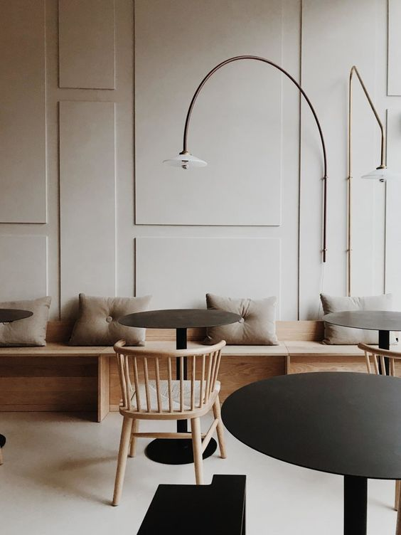 Modern Geometric Panel Wall - August Pinterest 2020: Top 15 Inspiration & Ideas: A beautiful, understated but effective geometric panelled wall design. Which serves as a feature wall to this modern seating area cafe. @chloedominik #modernfeaturewalldesign #panelledwalls #panelledwalldesign #geometricwalldesign