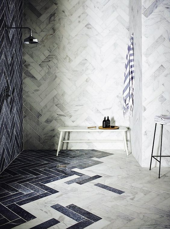 Blue and White Marble Bathroom - August Pinterest 2020: Top 15 Inspiration & Ideas: A gorgeous modern blue and white marble wet room finished in a marble herringbone pattern tile transitioning from the wall blue marble tiles into the white floor tiles. @chloedominik #wetroomideas #whiteandbluebathroom #herringbonetilebathroom #herringbonewetroom #marblewetroom #marbleherringbonebathroom