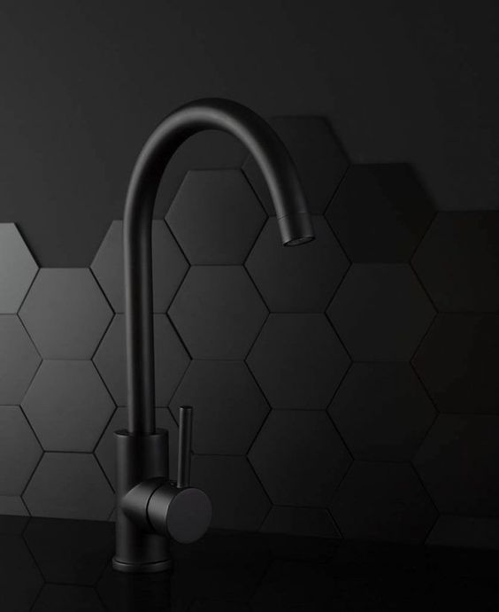 All Black Kitchen Finishes - August Pinterest 2020: Top 15 Inspiration & Ideas: Using all black for a kitchen means mixing up the finishes and textures. A matte black hardware tap, polished counter top and hexagon patterned tiles with a paint finish above keeps it all interesting. @chloedominik #blackkitchenfinishes #blackmattekitchen #blackhardwarekitchen #blackkitchencountertops #allblackkitchen #blackkitchenideas