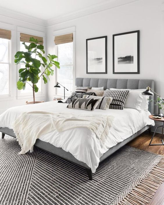 Modern Bedroom Rug - How To Choose The Right Area Rug: A patterned and textured rug under the bed sets the tone for this modern neutral bedroom design adding warmth and practicality by the rug placement under the bed. @chloedominik #howtochoosearug #arearugs #interiordesigntipsrugs #modernbedroom #choosinganarearug #arearugideas #bedroomrug #bedroomrugplacement #bedroomrugsunderthebed