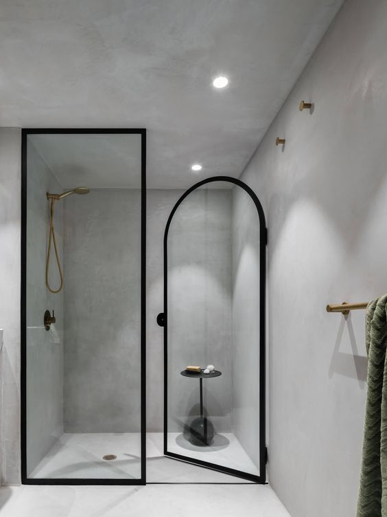 Contemporary Minimalist Bathroom - August Pinterest 2020: Top 15 Inspiration & Ideas: A minimal contemporary bathroom in a smooth concrete render with black and gold fixtures and finishes. Design by Matt Woods. @chloedominik #contemporaryminimalistbathroom #concretebathroom #concretebathroomdesign #minimalbathroom #minimalbathroomdesign
