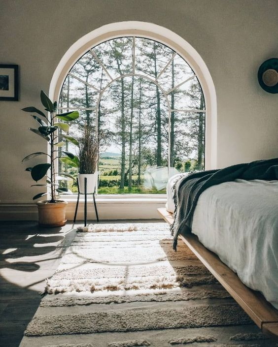 Bedroom Arched Window View - 7 Amazing Tips To Start Designing Your Space When Stuck: If you have an area to highlight like this beautiful arched bedroom window focal point then the beautiful view should always steal the show. @chloedominik #archedwindow #archedwindowsbedroom #windowfocalpoint #windowfocalpointbedroom #howtostartdesigningyourhome #designyourroom