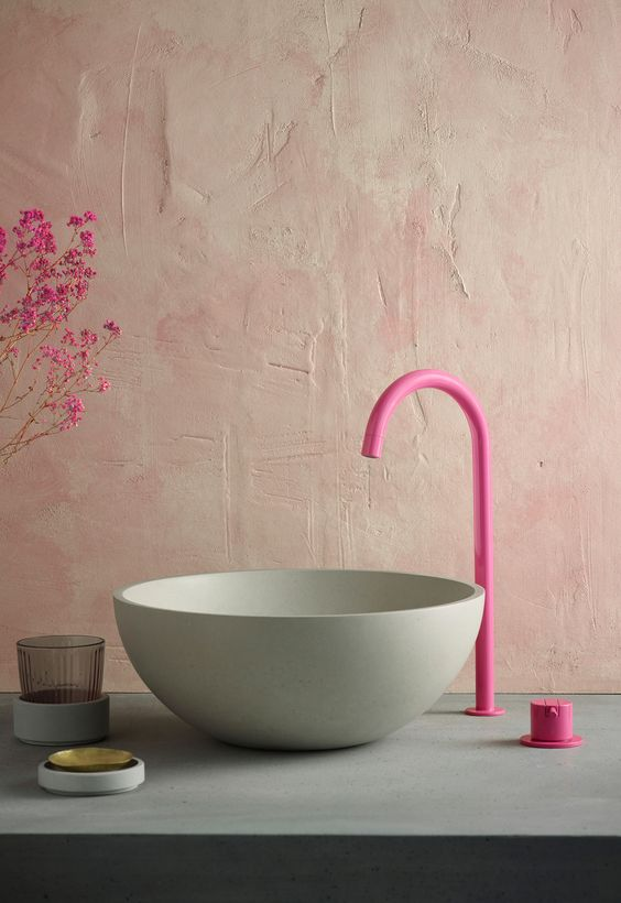 Pink Bathroom Hardware Fixture - August Pinterest 2020: Top 15 Inspiration & Ideas: A modern hot pink faucet fixture contrasts the other colours and finishes in the bathroom like the concrete vessel sink but that compliments everything so well. A different and unique design for bathroom finishes. @chloedominik #pinkbathroomhardware #bathroomfixtures #modernbathroomfixtures #modernbathroomfixturesfaucets #bathroomfinishesideas