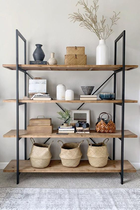 Open Styled Shelf Display - 12 Tricks To Make Your Living Room Seem Larger: Make use of your ceiling height with shelving to style and organize you accessories and personal items like this open styled shelf display in the living room. @chloedominik #openshelving #styledshelves #styledshelveslivingroom #styledopenshelves #livingroomtips #livingroomtipsandtricks
