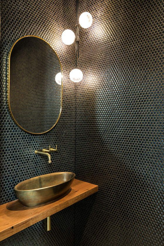 Black & Gold Powder Room -  September Pinterest 2020: Top 15 Inspiration & Ideas: An elegant black powder room tiled in small black circle tiles fitted with a modern corner pendant light and gold finished for the taps hardware, mirror and vessel sink. @chloedominik #powderroom #powderroomideas #blackandgoldpowderroom #blackpowderroom