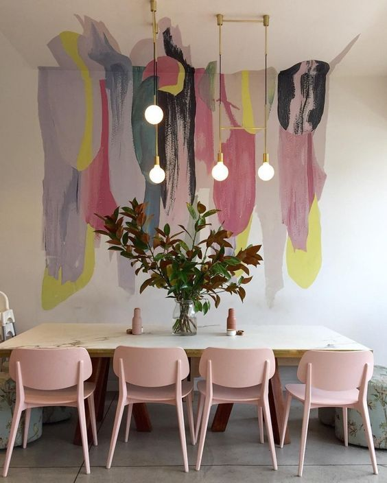 Abstract Paint Mural Wall - 20 Amazing Statement Ceiling Design Ideas For Your Home: Although this abstract paint mural is only partially on the ceiling the way its laid on both the ceiling and the fall has a nice effect in this modern dining area space. So you don't always have to go all out on a ceiling to make a difference in a room. @chloedominik #ceilingideas #ceilingideasdiningroom #abstractpaintmural #wallmural #wallmuraldiningroom #wallmuraldiningroomwallpapers