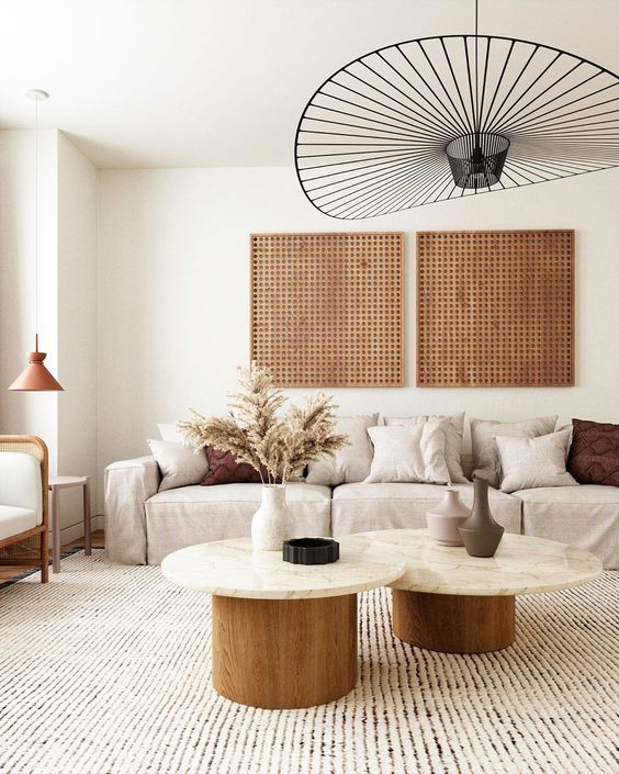 Beautiful Warm Living Room - 8 Popular Pendant Lights & Dupes That Will Look Great In Any Room: A beautiful neutral living room in cream and warm wood and earth tones which make it calming but cozy styled with minimal decor and topped with the stunning vertigo pendant lamp in black. @chloedominik #pendantlights  #pendantlightfixtures #popularlightfixtures #pendantlightdesign #vertigopendantlight #vertigopendantlightlivingroom #warmneutrallivingroom #warmneutrallivingroomearthtones