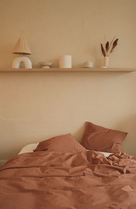 Minimal Earthy Bedroom - What Are The Surprising & Big Colour Predictions For 2021?: A beautiful earthy minimally styled bedroom with shelf ledge decorated with accessories. What are colours are on the radar for this upcoming year of 2021? What colours have the big brands and companies predicted will be the favourites in the homes and what these colours will bringing in to our lives, emotionally and our well-being. @chloedominik #earthybedroom #earthytonesbedroom #minimalstyledshelves #bedroomledgedecor