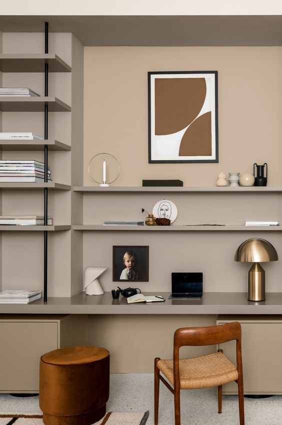 Dulux Brave Ground Home Office - What Are The Surprising & Big Colour Predictions For 2021?: The light and warm earthy neutral, Brave Ground paint color has been used in this home office. A cool and modern home office making use of the wall space and styled with artwork and accessories. #homeoffice #homeofficeideas #homeofficedesign #braveground #bravegroundcolor #bravegroundduluxpaint #duluxpaint #lightwarmneutralpaint #lightwarmneutrals