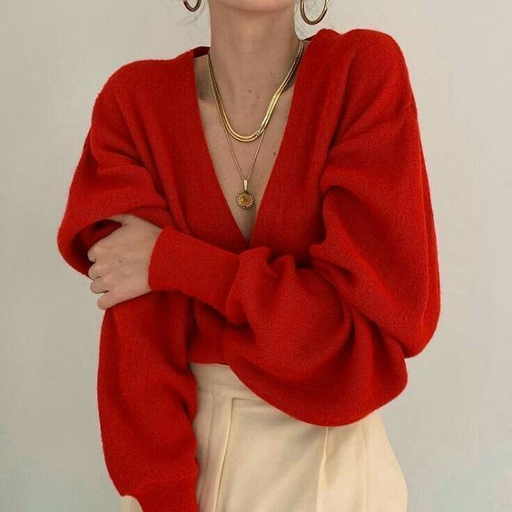 Low Cut V Neck Red Sweater - December Pinterest 2020: Top 15 Ideas & Inspiration: Gorgeous low cut red sweater with tight cuff sleeve layered with gold necklaces and gold earring hoops and cream trousers. A classy red and cream winter outfit. #redandcreamoutfit #redandcreamoutfitwinter #redandcreamoutfitclassy #redsweateroutfit #redsweateroutfitwinter #redsweatergoldnecklace