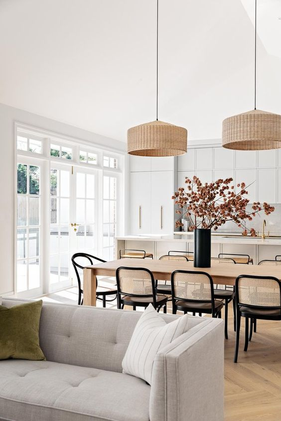 Modern Open Concept Coastal Kitchen Dining - December Pinterest 2020: Top 15 Ideas & Inspiration: A beautiful modern styled coastal open concept kitchen, dining area and living room area with wicket lighting pendants and rattan backed chairs makes a gorgeous homely and relaxed space. Interior design by Fliss and Leah Pittman of Bone Made Interior design studio Australia. #openkitchen #openkitchenanddiningroomlayout #moderncoastaldesign #moderncoastaldesigninteriors #moderncoastalkitchen