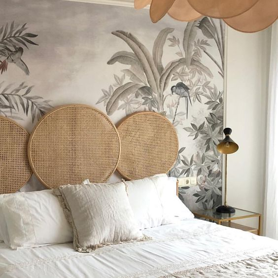 Safari Styled Bedroom Interior - 20 Stunning Rattan Beds & Headboard Ideas For The Bedroom: Triple round caned headboard with a tropical and botanical wallpaper as a backdrop giving a safari style interior. Interior Design by Garnica Miguelena #roundheadboarddecor #rattanbedhead #rattanbedheadstyling #canedheadboardbedroom #rattanbedroomideas #safaribedroomadult #roundrattanheadboard