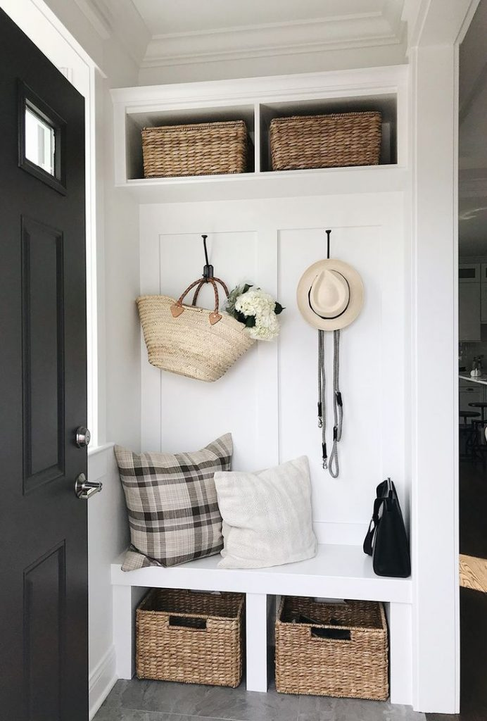 Built In Hallway Seating - 7 Great Tips To Organize & Style Your Hallway: A beautiful hallway entrance built in provides a great storage solution with a bench for seating to keep the front of the home neat and organized while looking great. #hallwaystorage #hallwaystorageideas #hallwaystoragebench #hallwaybuiltins #hallwaybuiltinstorage #organizehallway #hallwayorganizationstorage #hallwayorganizationideas