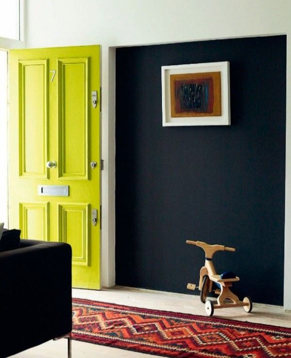 Neon Hallway Door & Dark Contrast Wall 7 Great Tips To Organize & Style Your Hallway: A vibrant pop of neon yellow green colour on the front door entrance to hallway paired with a dark and deep navy wall makes an impactful welcome into the home with minimal decor and accessories for a hallway idea. #hallwaydesignideas #hallway #hallwaydesignshome #hallwaydesignideasentryway #neondoor #styledhallway #hallwaycolours #hallwaycolourideas