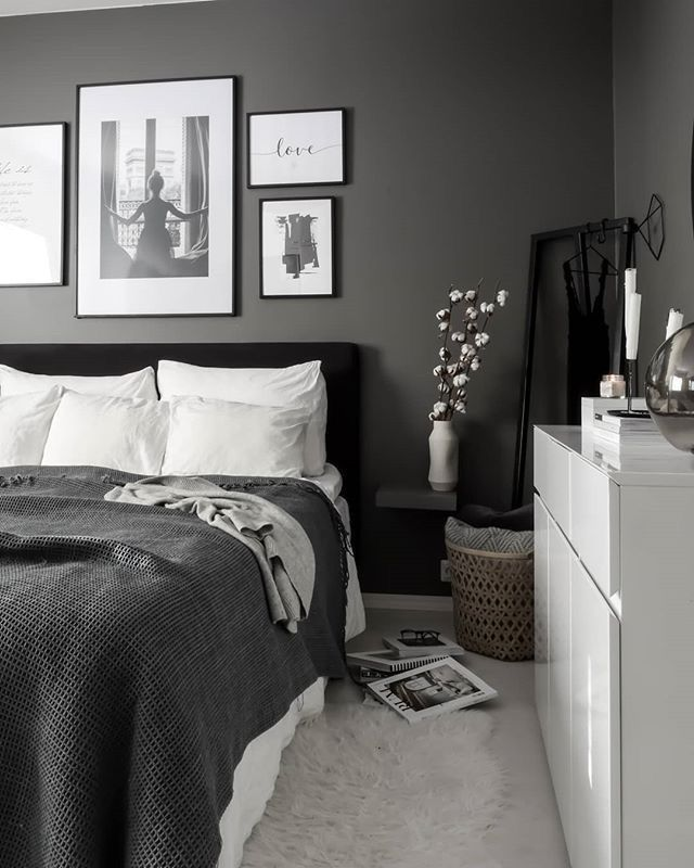 Dark Grey Modern Bedroom - 6 Tips To Refresh Your Bedroom Without Doing A Full Makeover: Beautiful calming bedroom with a focal wall painted dark grey with stylish black framed gallery wall above the headboard. Decorated minimal with neutral colours to compliment the black, white and gray color scheme. #modernbedroom #modernbedroominterior #modernbedroomdecor #darkgreybedroom #moderndarkgreybedroom #calmingbedroom #neutralbedroomideas #gallerywallbedroom