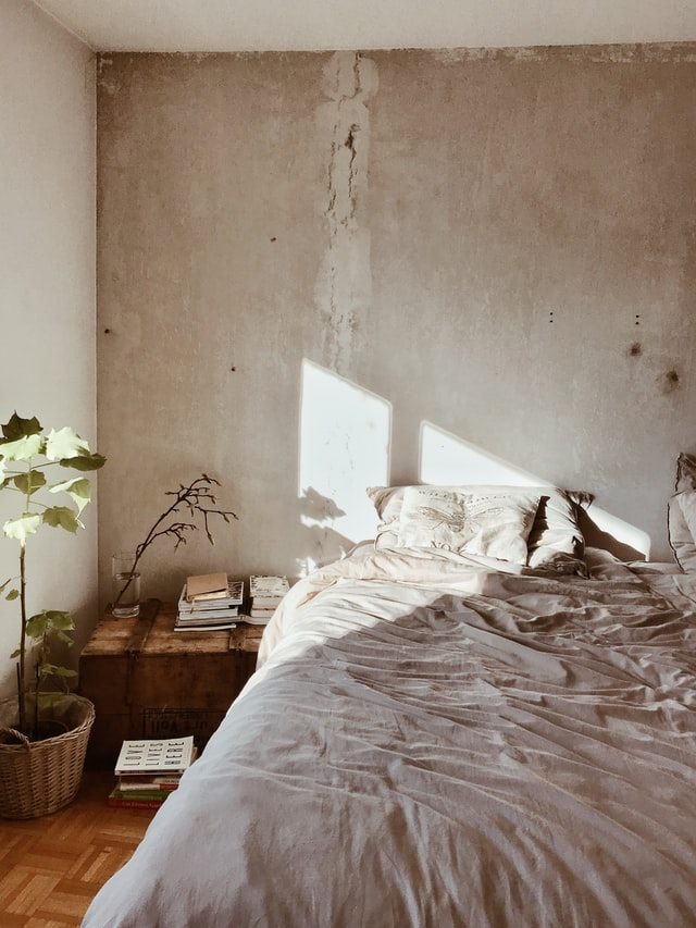 Beautiful Limewashed Bedroom Walls - 7 Ways To Achieve The Beautiful Wabi Sabi Aesthetic In Home & Life: A beautiful interior of a bedroom with limewashed walls and plaster. Creating the Japanese inspired concept of wabi sabi. A simplistic and understated beauty in home and life. wabi sabi| japanese inspired| wabi sabi bedroom| wabi sabi interior| wabi sabi home